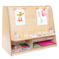 complete art area for art and design with easel and storage trays and pots
